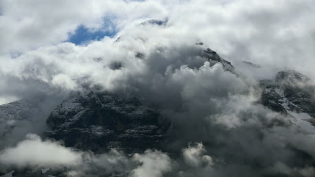 clouds at eiger north wall, bernese alps, canton of bern, switzerland - bernese alps stock videos & royalty-free footage