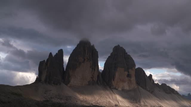 Clouds at the peak of Tre Cime Di Lavaredo (mountain). Tre Time Di Lavaredo, Sexten Dolomites, Dolomites, European Alps, Alto Adige, South Tyrol, Italy.
