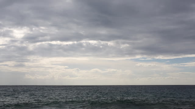 Clouds billow above seascape