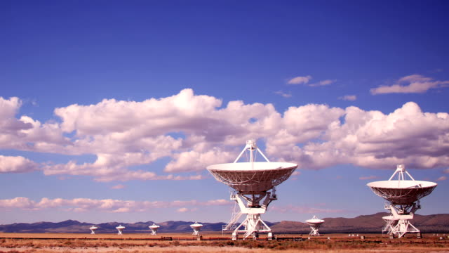 clouds billow above the very large array in new mexico. - 宇宙・天文点の映像素材/bロール