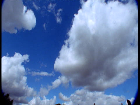 "vidéos et rushes de clouds billow in blue sky, uk - ""bbc natural history"""