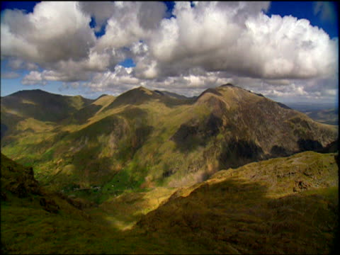 clouds billow over peaks of snowdon wales - snowdonia stock videos & royalty-free footage