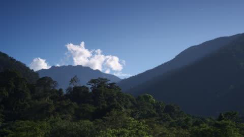 vidéos et rushes de tl clouds billow over rainforest and hills, sumatra - indonésie