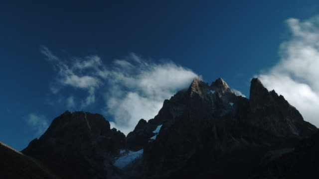 Clouds billow over rocky peak, Mount Kenya