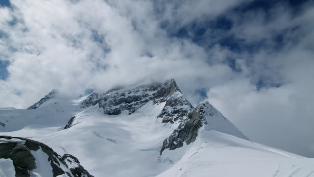 "clouds billow over swiss mountains - ""bbc universal"" stock-videos und b-roll-filmmaterial"