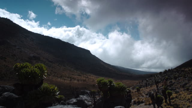 Clouds billow through valley, Mount Kenya