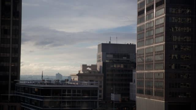 Clouds blow over Sydney buildings