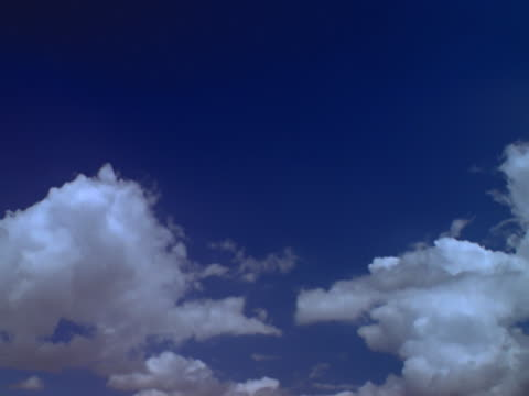 clouds blowing across sky - mpeg videoformat stock-videos und b-roll-filmmaterial