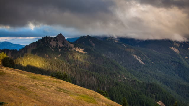 clouds blowing over mountain peaks in olympic national park - time lapse - olympic national park stock videos and b-roll footage