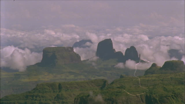 clouds boil over mountains. available in hd. - ethiopia stock videos and b-roll footage