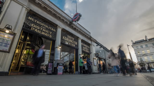 clouds build and move rapidly overhead as tourist and commuters move through the edwardian arcade an entrance to south kensington tube station - station stock videos & royalty-free footage