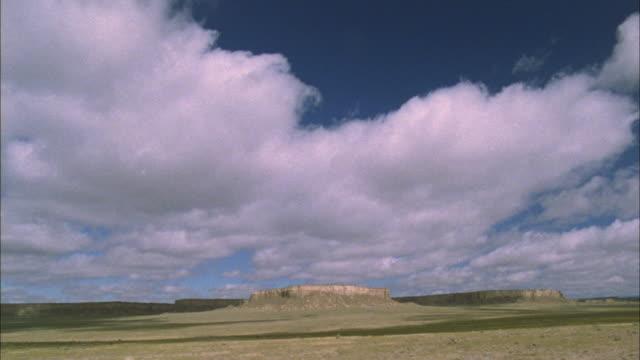 clouds cast shadows as they drift over arizona desert mesas. - arizona stock videos & royalty-free footage