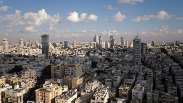 clouds cast shadows as they drift over downtown tel aviv. - tel aviv stock videos & royalty-free footage