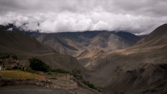 t/l clouds casting shadows over kagbeni, himalayas - foothills stock videos & royalty-free footage