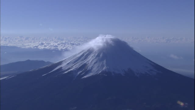 clouds collect on the snowy summit of mt. fuji. - mt fuji stock videos & royalty-free footage