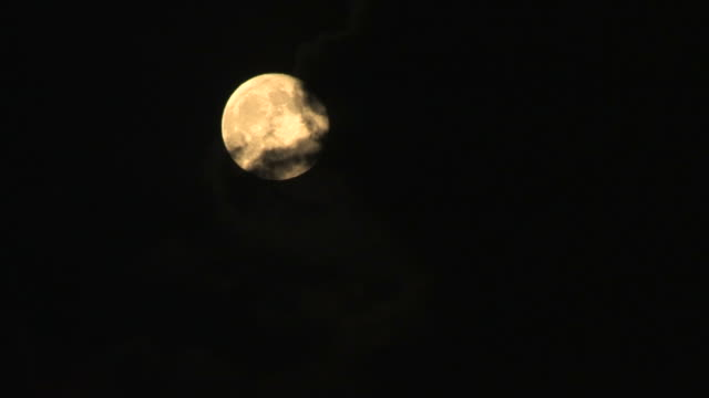 ws clouds covering full moon against black sky - hiding stock videos & royalty-free footage