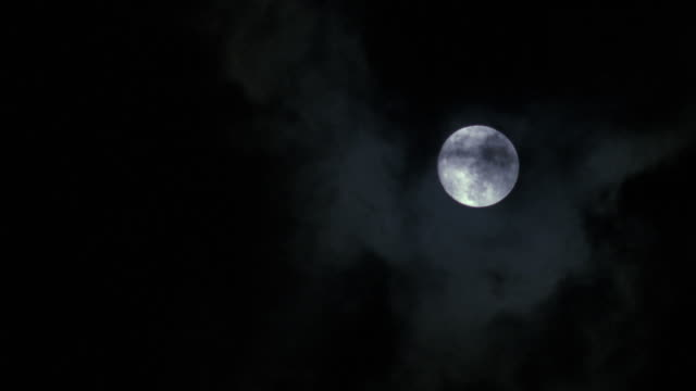 ms clouds covering moon completely - vollmond stock-videos und b-roll-filmmaterial