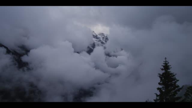 ws clouds covering snow capped alps / murren, switzerland - berner alpen stock-videos und b-roll-filmmaterial