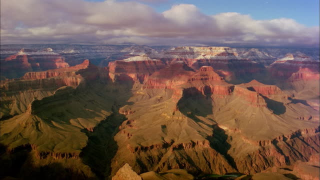 Clouds create shadows as they float over the Grand Canyon.