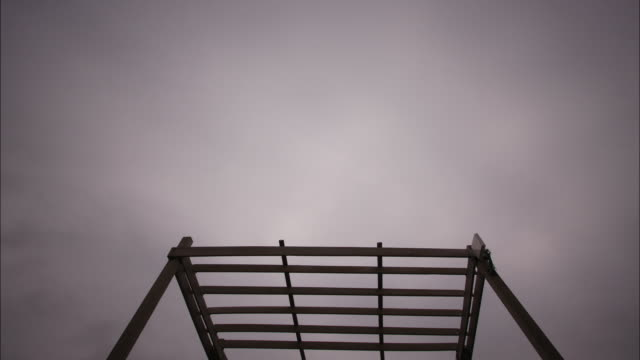 clouds drift above a boat in a dry dock. - dry dock stock videos & royalty-free footage