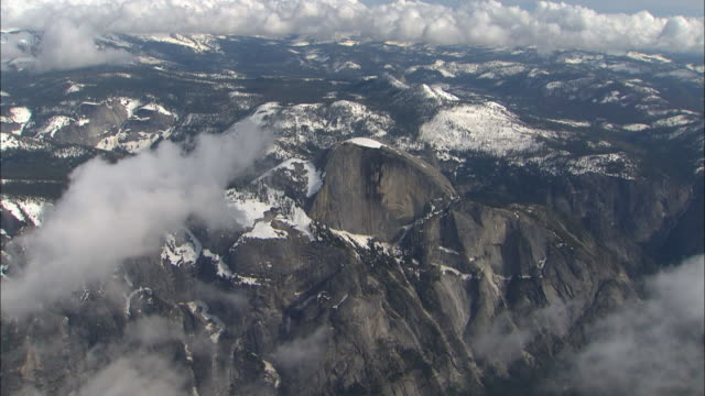 clouds drift above a snowy mountain landscape. - mariposa county stock videos and b-roll footage