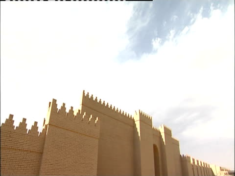 clouds drift above babylonian ruins. - babylon stock videos and b-roll footage