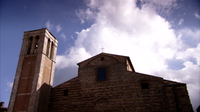 clouds drift above church of santa maria delle grazie and bell tower in montepulciano. available in hd. - montepulciano stock videos & royalty-free footage