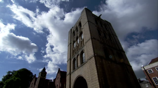 clouds drift above the norman tower in bury st edmunds. available in hd. - bury st edmunds stock videos & royalty-free footage