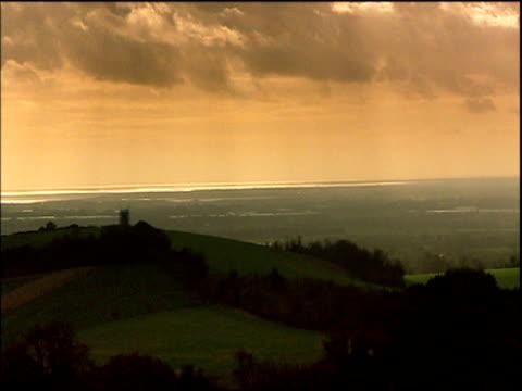 clouds drift across sunset above south downs sussex - hügelkette stock-videos und b-roll-filmmaterial