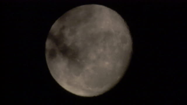 Clouds drift across the moon. Available in HD.
