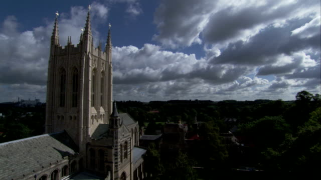 clouds drift behind the ornate tower of bury st edmunds cathedral. available in hd. - bury st edmunds stock videos & royalty-free footage