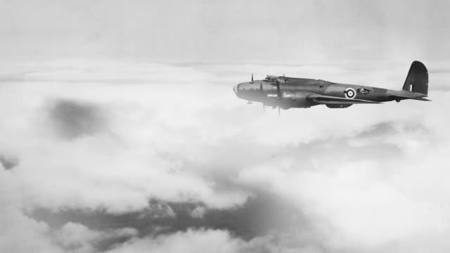 clouds drift by a photographic image of the royal air force boeing b-17 flying fortress of world war ii. - royal air force video stock e b–roll