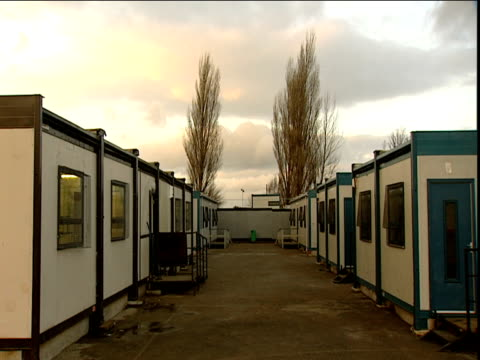 Clouds drift by temporary school buildings