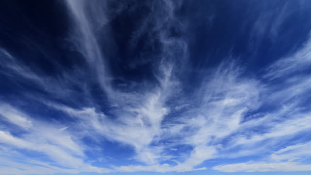 clouds drift in blue sky - 1 minute or greater stock videos & royalty-free footage