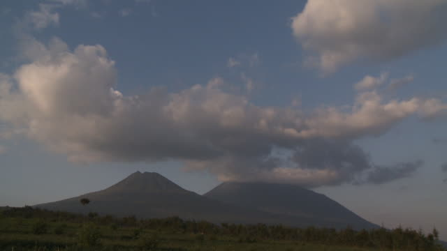 Clouds drift over a volcano in the Volcanoes National Park of Rwanda. Available in HD.