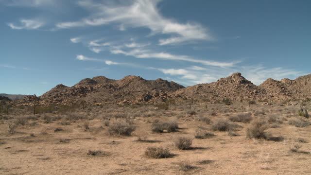 Clouds drift over desert in Joshua Tree National Park