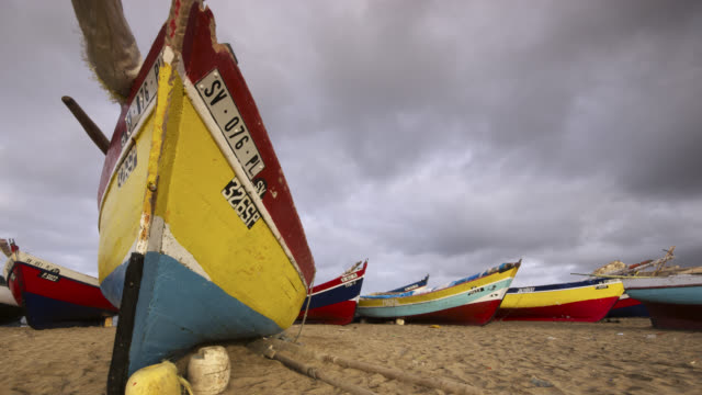 tl clouds drift over fishing boats, cape verde - verde color stock videos & royalty-free footage
