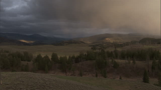 clouds drift over hills, yellowstone, usa - rolling landscape stock videos & royalty-free footage