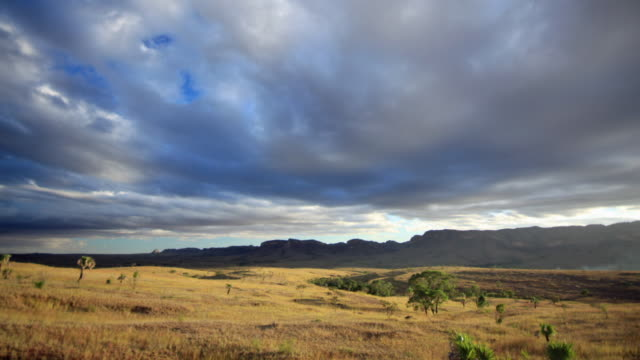 clouds drift over rocky plateau, madagascar - plateau stock videos and b-roll footage