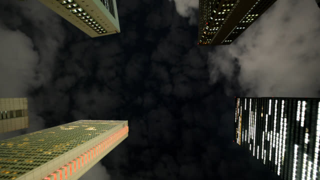 Clouds drift over skyscrapers.