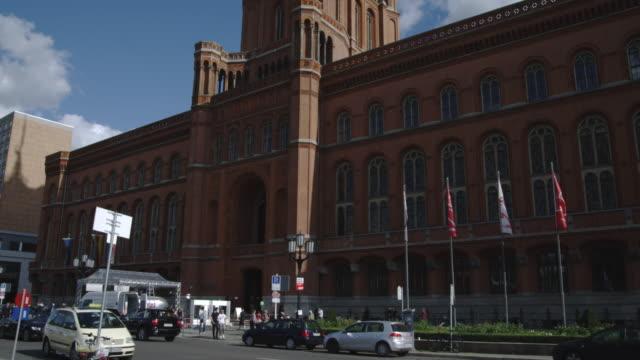 clouds drift over the clock tower on rotes rathaus in berlin. - rathaus bildbanksvideor och videomaterial från bakom kulisserna