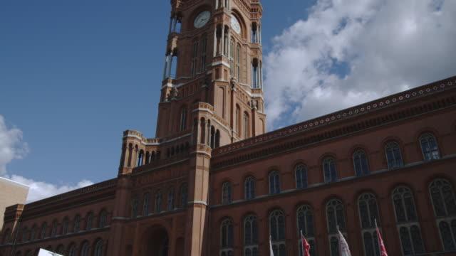 clouds drift over the clock tower on rotes rathaus. - rathaus bildbanksvideor och videomaterial från bakom kulisserna