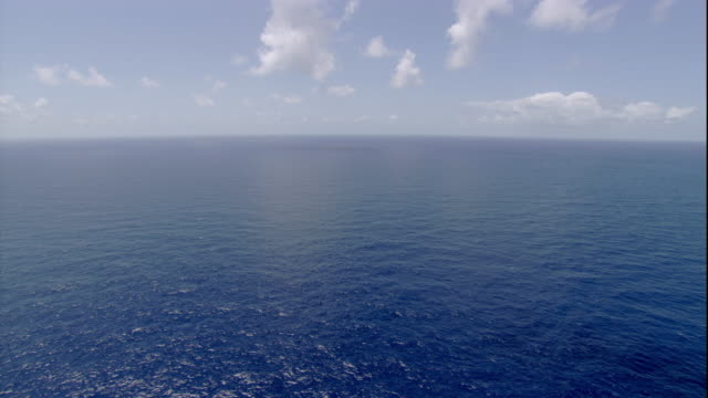 Clouds drift over the Pacific Ocean near Australia. Available in HD.