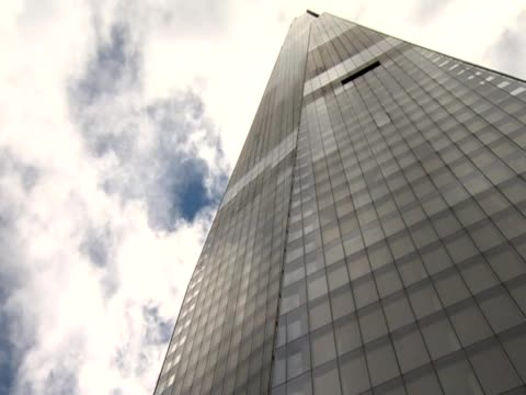 clouds drift over the shard - fensterfront stock-videos und b-roll-filmmaterial