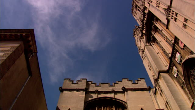 clouds drift over the wills memorial tower on the campus of the university of bristol. - bristol university stock videos and b-roll footage