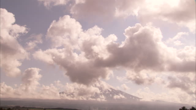 clouds drift past mount fuji. - geology stock videos & royalty-free footage