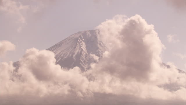 clouds drift past mount fuji. - mt fuji stock videos & royalty-free footage