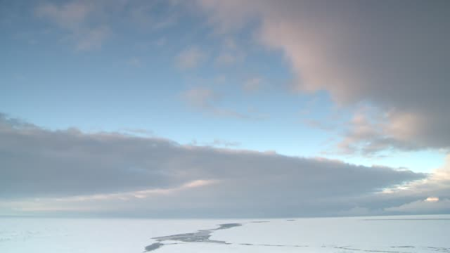 Clouds drift quickly over the ice-covered ocean in Antarctica. Available in HD.
