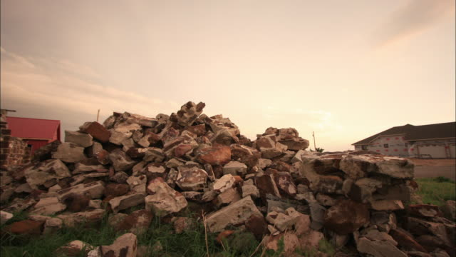 clouds drift through the sky above a pile of rubble from a wrecked house. - oklahoma stock-videos und b-roll-filmmaterial