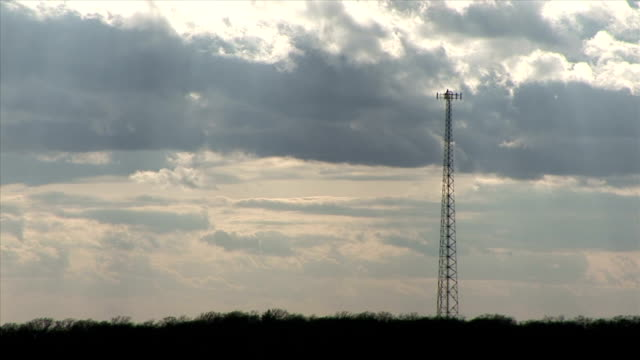 clouds drifting by communication tower - microwave tower stock videos & royalty-free footage